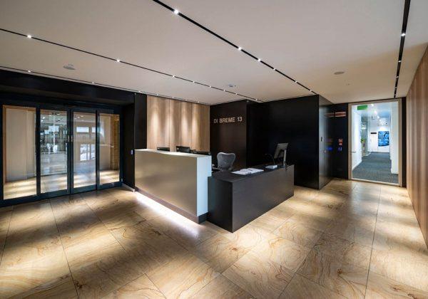 Pareti divisorie in legno e vetro uffici Bayer - Evolvinwall
